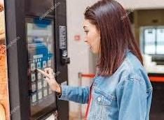Girl Buying from Vending Machine